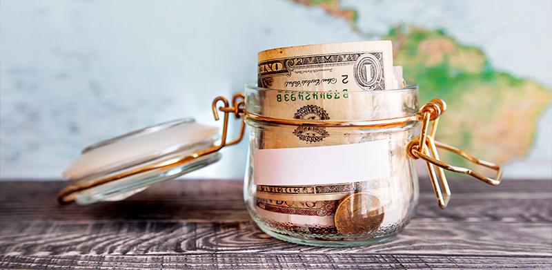 Como planejar e organizar gastos e juntar dinheiro para uma viagem para o exterior - Inglês Falado